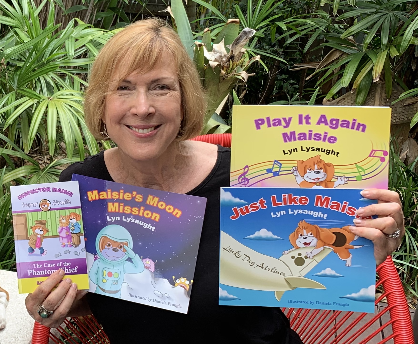 Lyn Lysaught Showcasing Her Books