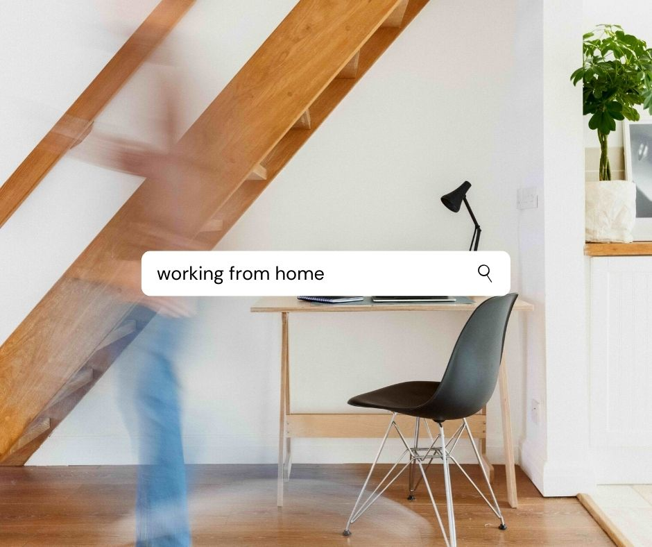 A home office with a human figure. 'Working from home' is written in a search bar across the middle.
